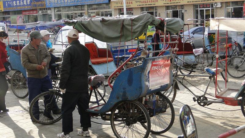 Transsibirische Eisenbahn: China - Erlian, Rikschas