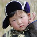 Transsibirische Eisenbahn: kleiner Mongole in Nationaltracht XS